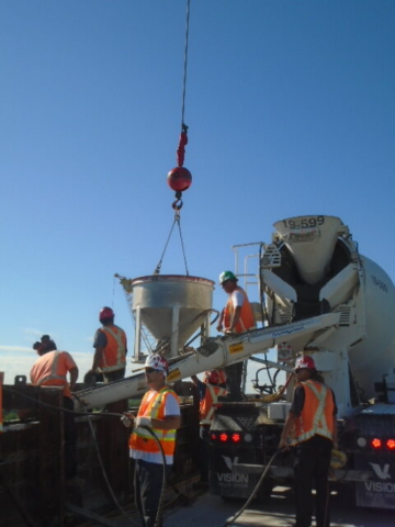 Placing and vibrating concrete, hopper placing concrete into form work