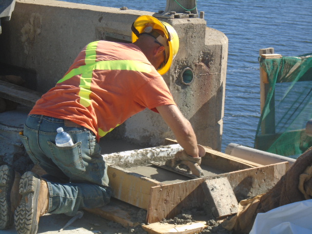 Forming and troweling the deck end for the temporary expansion joint
