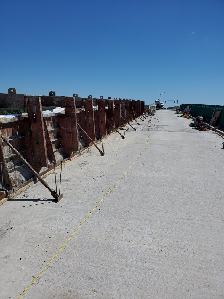 Barrier wall form work after the completion of the concrete placement
