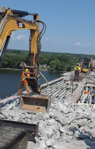 Concrete rubble being removed / containment system