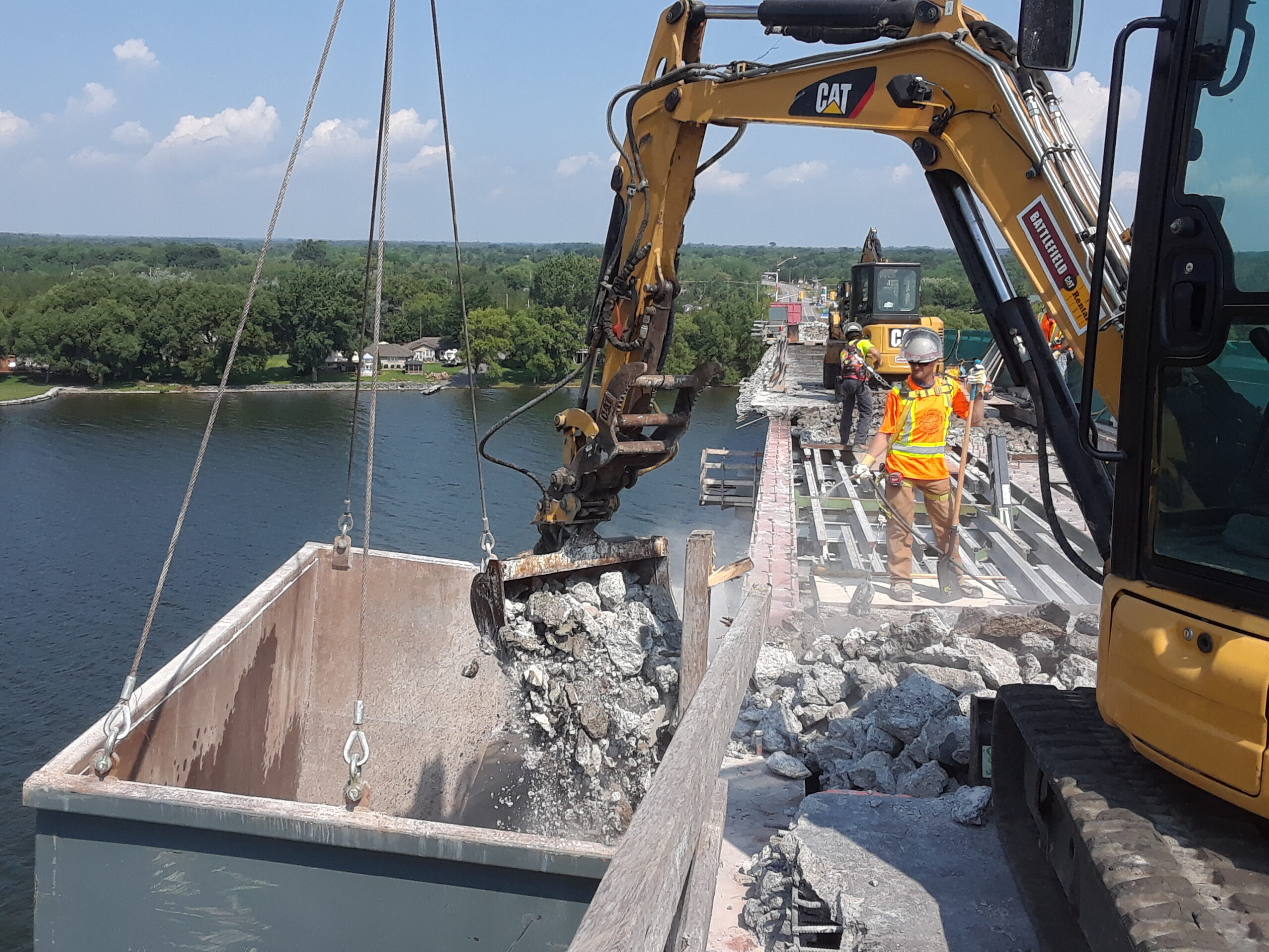 Concrete being removed to the containment bin / keeping the debris damp for dust control