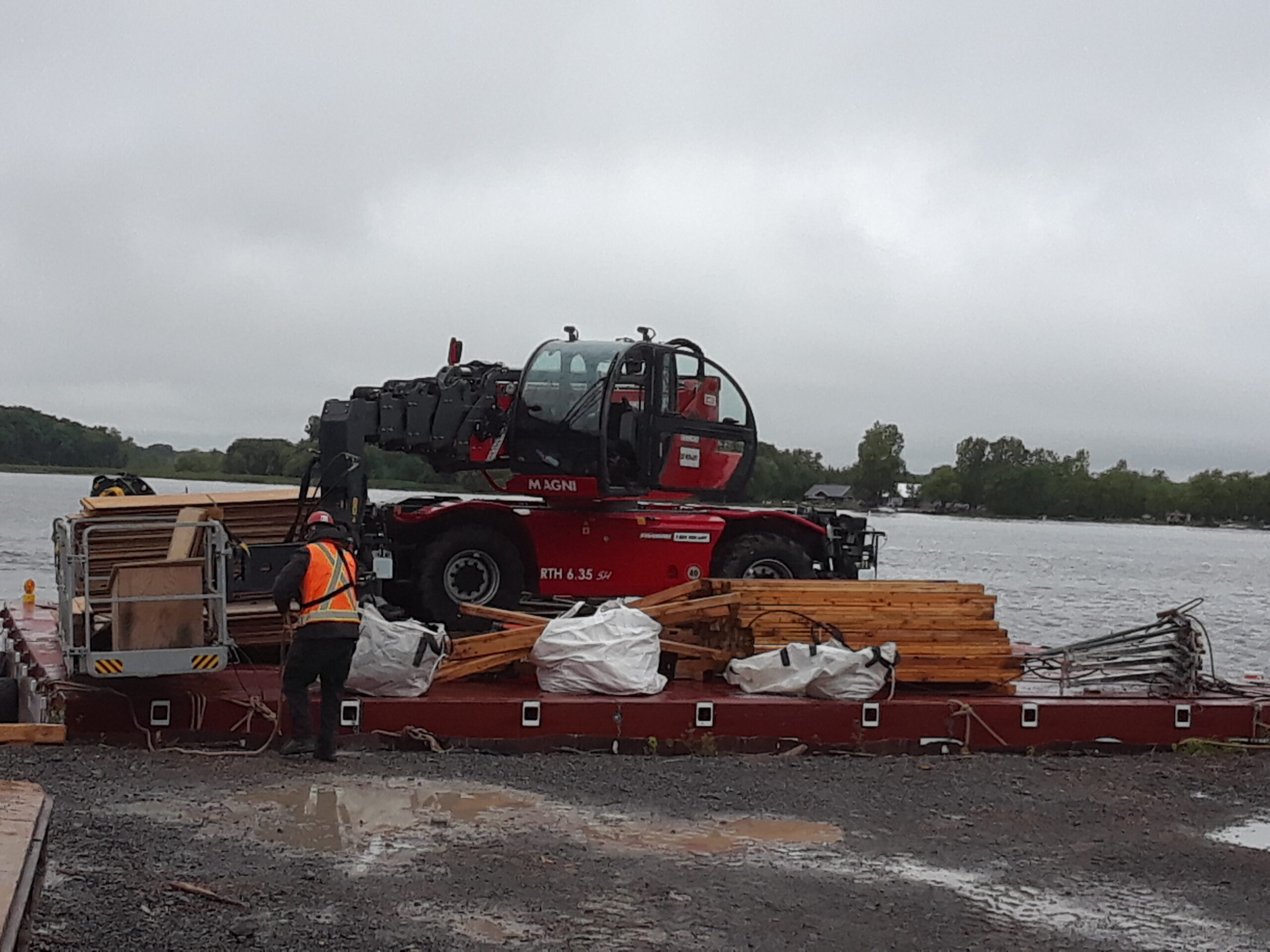 Magni barge being brought into job site to unload false decking