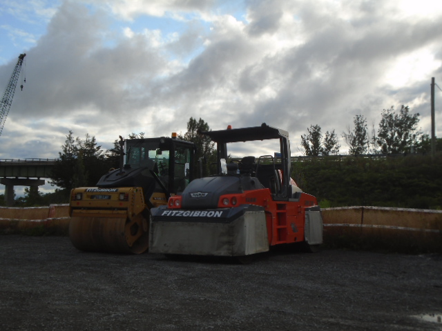 Steel drum roller and rubber tire roller delivered to site for asphalt placement