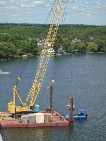 Generator being lifted from the boat onto the barge