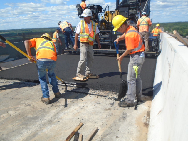 Second placement of asphalt being placed, tamped and evened out