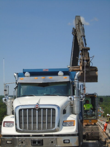 Removed asphalt being loaded into the truck