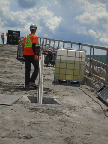 Lowering pieces of containment system to the false deck