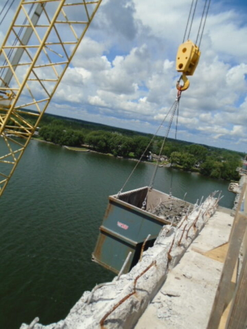 Containment bin for concrete rubble being lifted to the deck by the crane on the barge