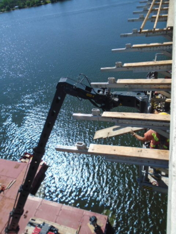 Removal of work platform and brackets on the east side using the Magni lift