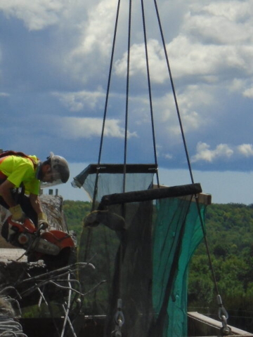 Cutting rebar during barrier wall removal