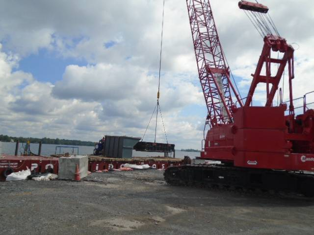 Removing the containment bins from the barge with the 110 ton crane
