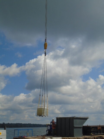 Loading the water container onto the barge