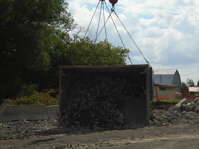 Emptying the containment bin of concrete rubble
