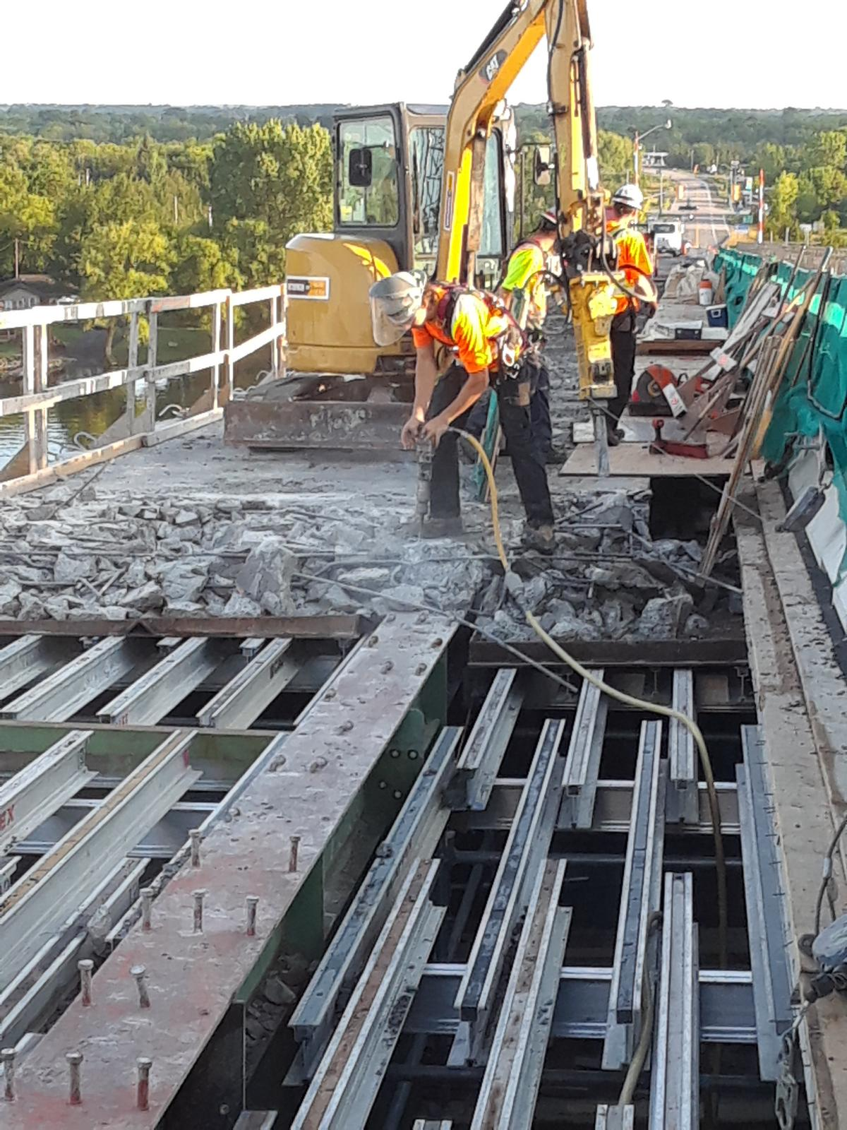 Chipping concrete on the girders