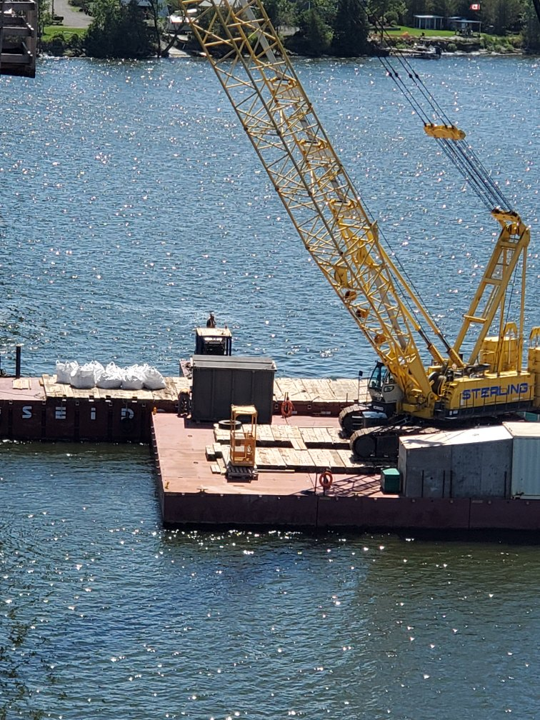Removing meter bags of debris on the barge to the project site