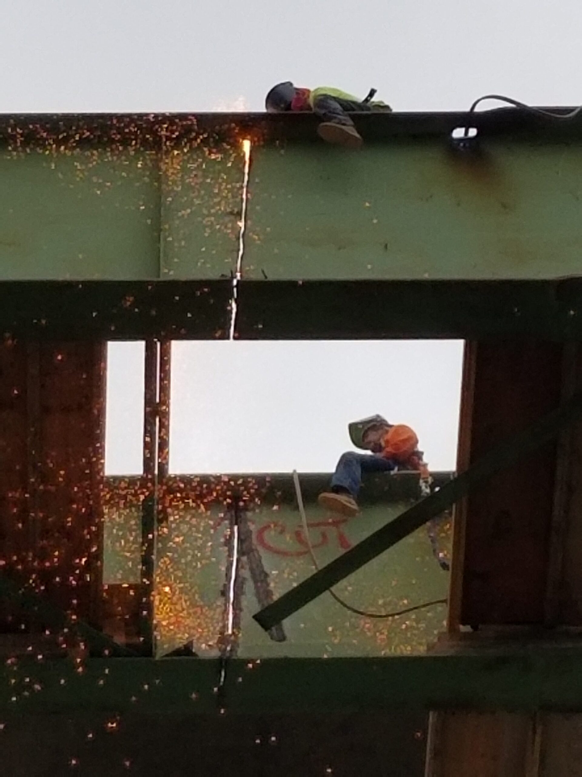 Torch cutting the girder for removal