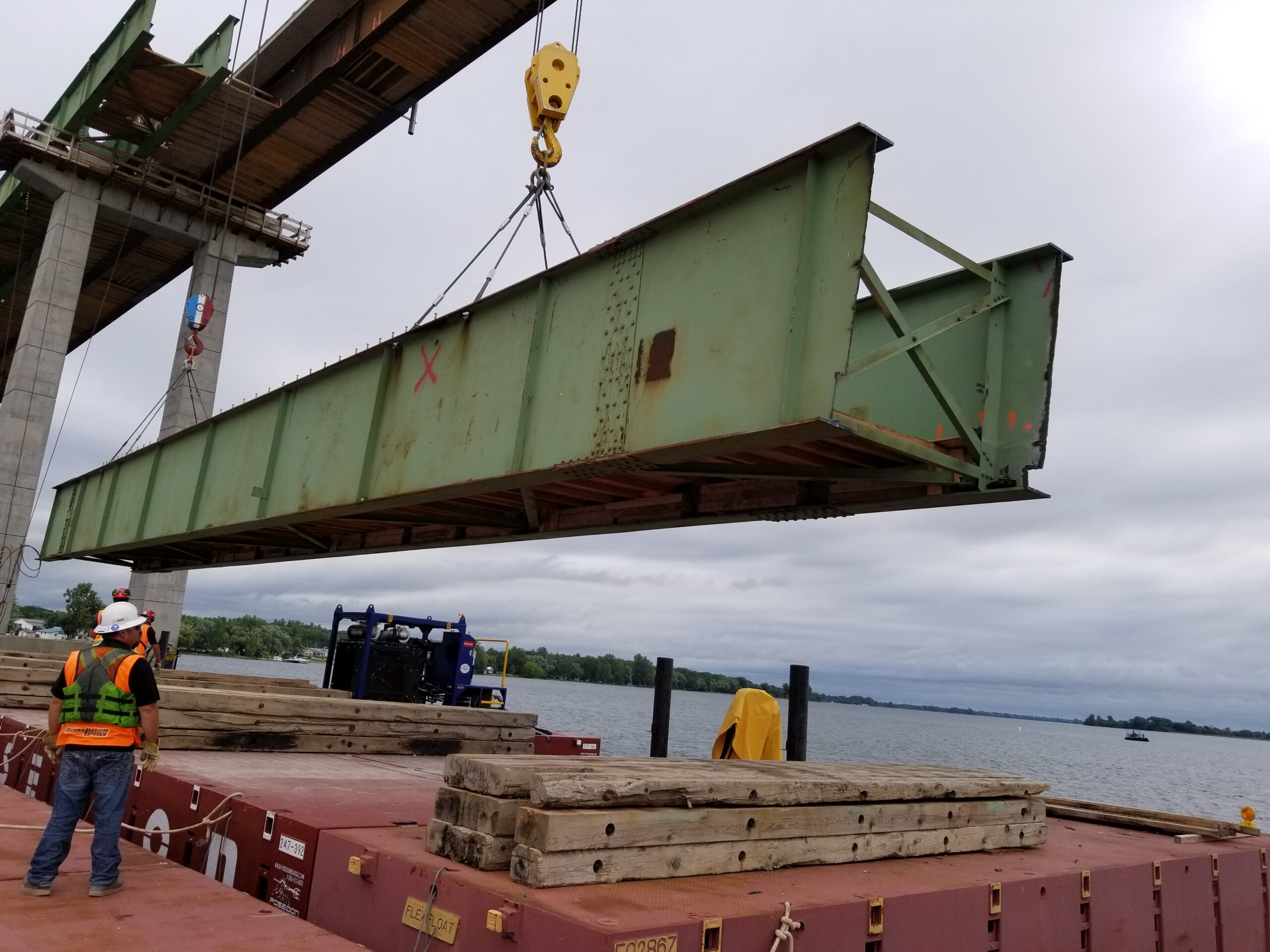 Lowering the first removed girder section onto the barge