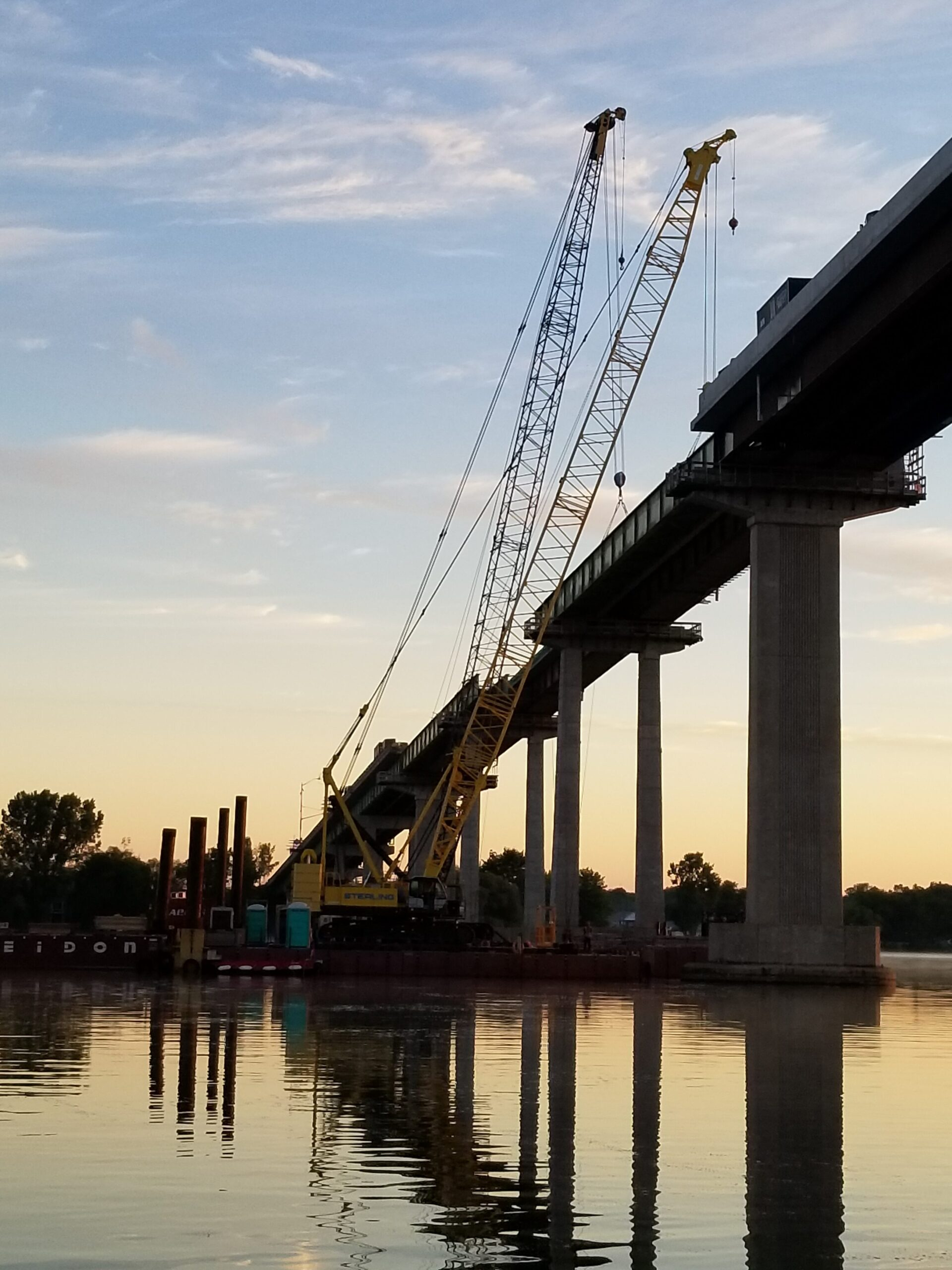 Approach girder hooked up to both cranes preparing for removal