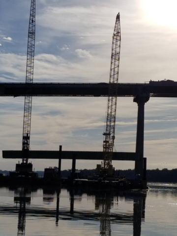 Approach girder being lowered onto the barge
