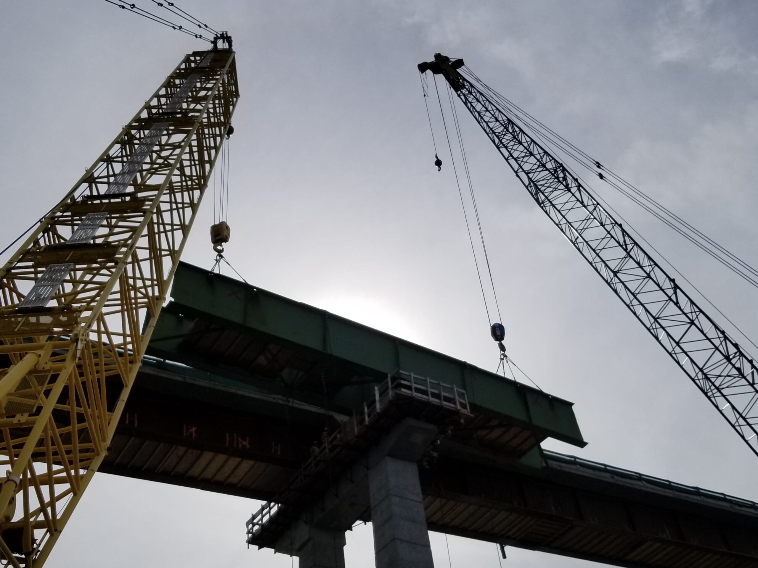 Both cranes hooked up to the first haunch girder removal