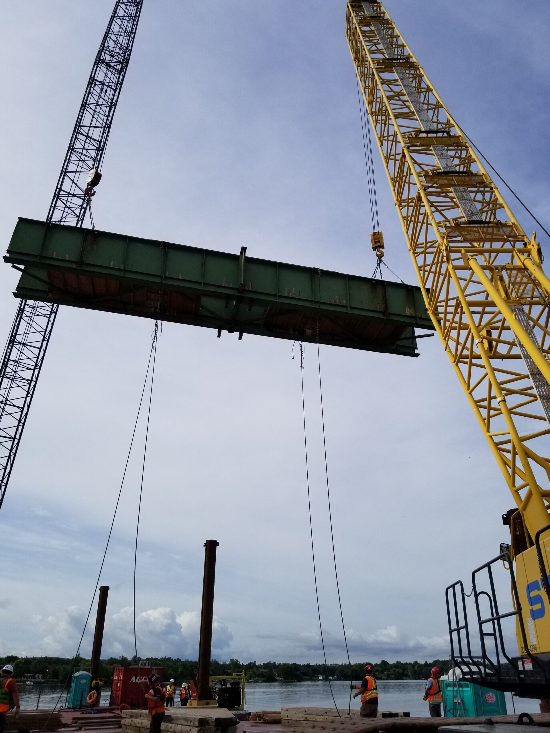 Both cranes lowering the first haunch girder to be removed