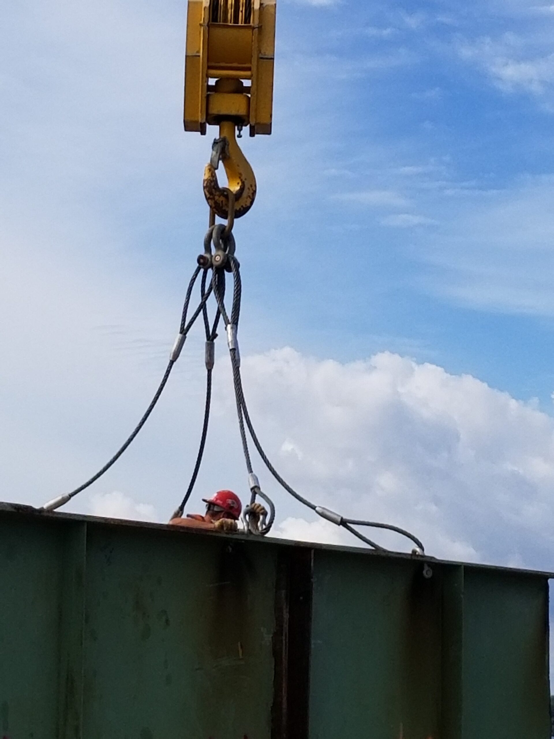 Removing the crane cables from the removed girder