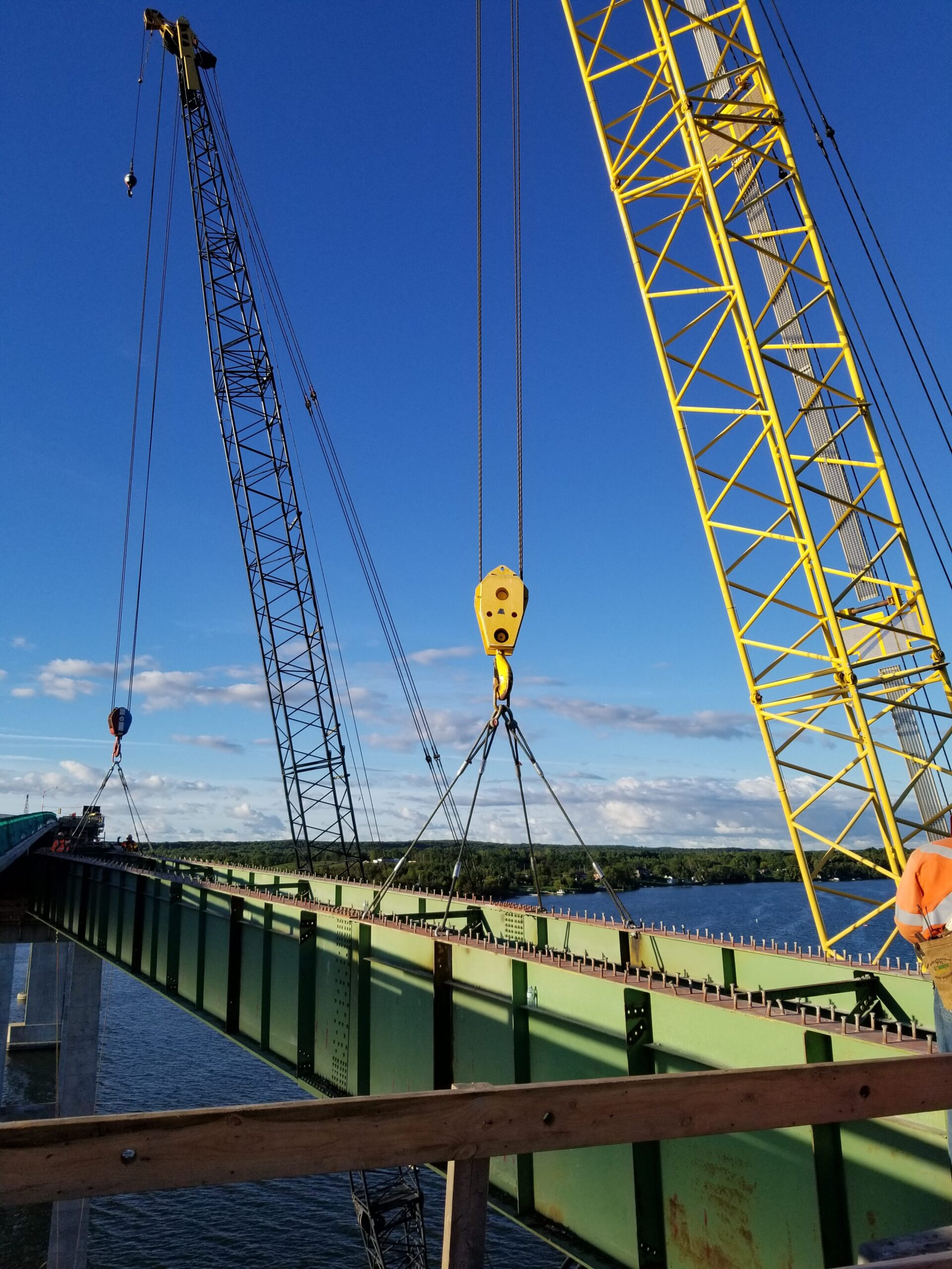 Swinging the second approach girder to be lowered