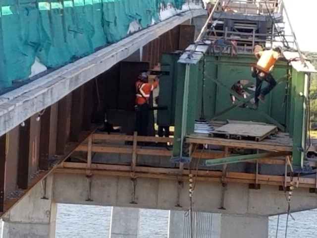 Removing the temporary transverse bracing from the haunch girder