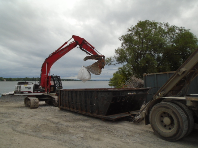 Removing debris bags from containment bin
