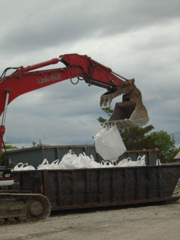 Removing metre bags from the containment bin