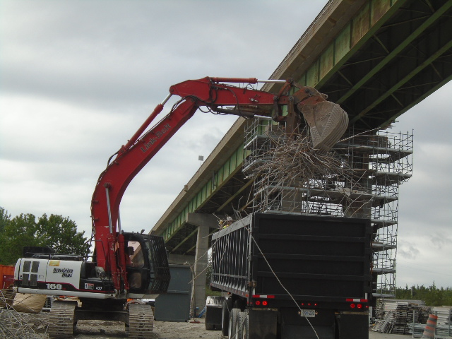 Rebar and steel being loaded and removed from site