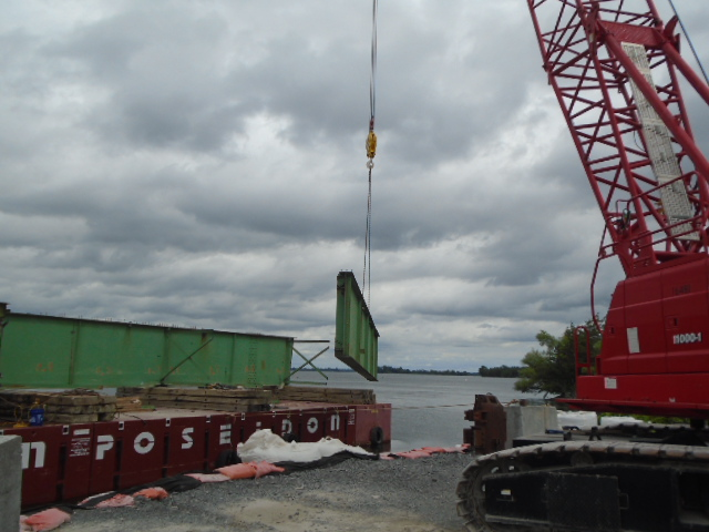 Section of cut girder being removed by 110 ton crane