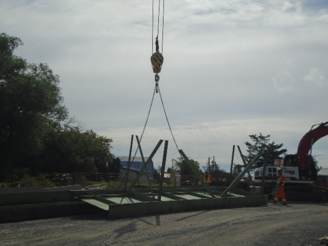 110 ton crane lowering the girder section to be dismantled