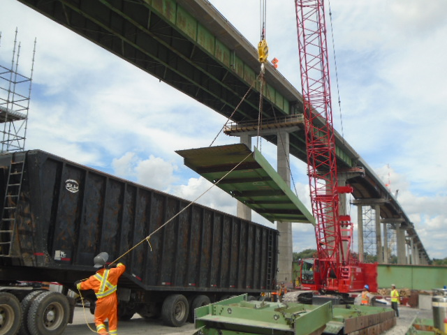 Girder section being lowered onto the truck for removal from site