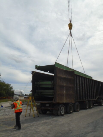 Girder section being lowered into the truck