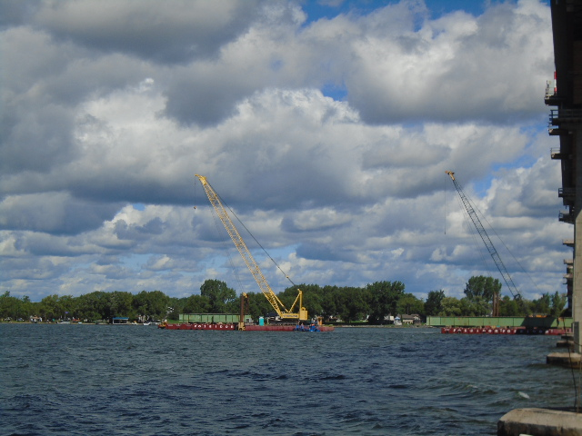 Final two removed girder sections being moved by barge