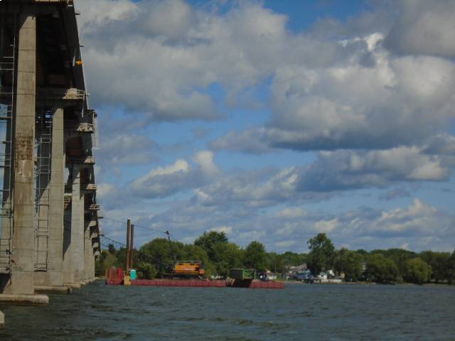 Moving one of he 200 ton cranes and girder section to the east side of the bridge