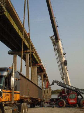 Preparing to remove the second approach girder from the truck