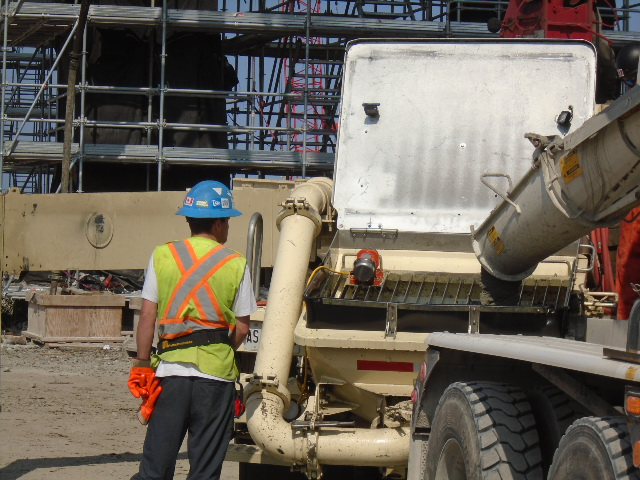 Concrete being placed into the concrete pump truck