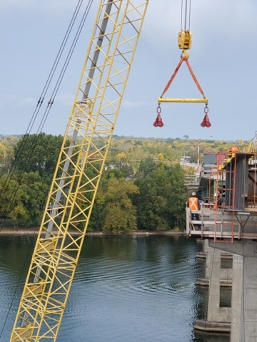 Removing the spreader bar from the installed haunch girder