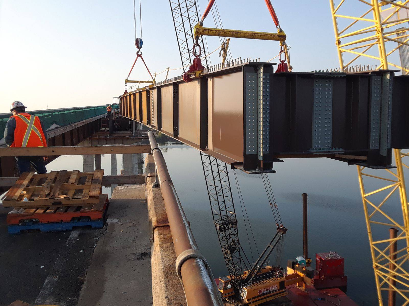 Lowering the second approach girder into place