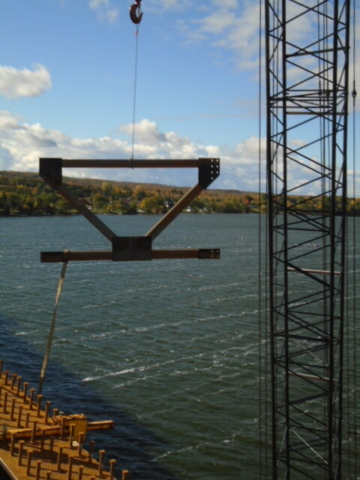"Lifting the ""K"" bracket to the installed girders for installation"