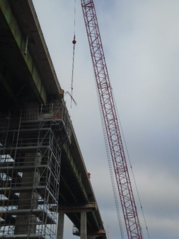 Lowering rebar to pier 13 for installation
