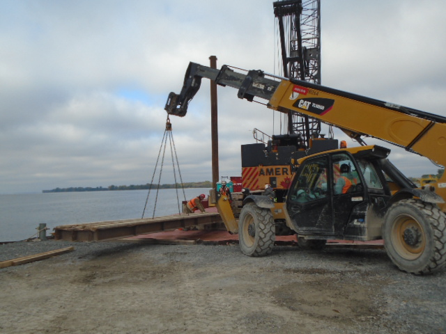 Placing the ramps on the barge for crane removal