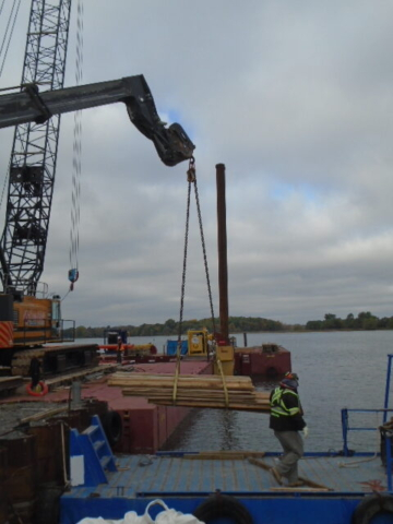 Loading wood onto the barge with the telehandler to take to the barge