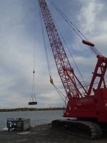 110 ton crane ready to load wood onto the boat