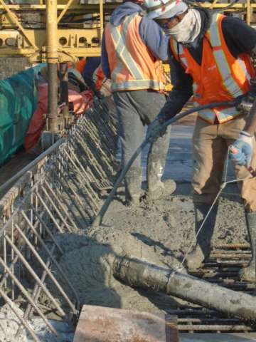 Pumping and vibrating concrete into formwork