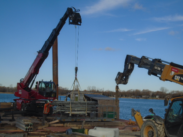 Scaffolding pieces being removed from the barge
