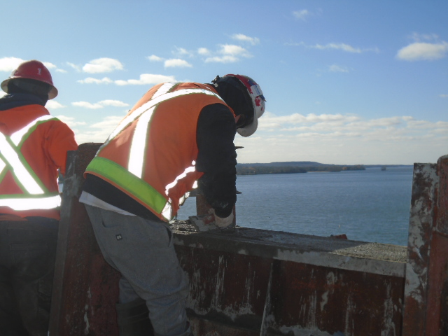 Troweling the newly placed concrete on the barrier wall