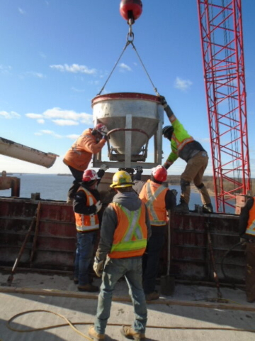 Using the concrete hopper to release concrete into the formwork